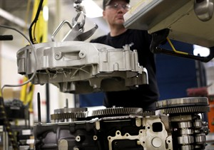 In this March 26, 2014 photo, Jerry Drury works on a truck engine assembly line at Volvo Trucks' powertrain manufacturing facility in Hagerstown, Md. The Institute for Supply Management, a trade group of purchasing managers, issues its index of manufacturing activity for May on Tuesday, July 1, 2014. (AP Photo/Patrick Semansky)