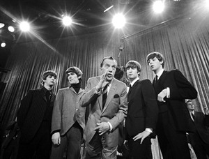 "FILE - In this Feb. 8, 1964 file photo, Ed Sullivan, center, stands with The Beatles, from left, Ringo Starr, George Harrison, John Lennon, and Paul McCartney, during a rehearsal for the British group's first American appearance, on the ""Ed Sullivan Show,"" in New York. The Beatles made their first appearance on ""The Ed Sullivan Show,"" America's must-see weekly variety show, on Sunday, Feb. 9, 1964. And officially kicked off Beatlemania. Ron Howard will direct a documentary on the Beatles that focuses on the band's touring years during the early 1960s. Howard announced the project Wednesday. The film is being made with the cooperation of Paul McCartney, Ringo Star, Yoko Ono and Olivia Harrison. The Beatles company, Apple Corps, is co-producing the film. (AP Photo/File)"