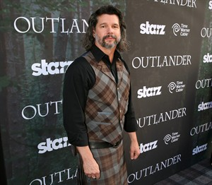 "FILE - This July 25, 2014 file photo released by Starz shows executive producer Ronald D. Moore arriving at the premiere for the Starz original series ""Outlander"" during San Diego Comic-Con in San Diego. ""Outlander"" premieres on Aug. 9. (AP Photo/Starz, Matt Sayles)"