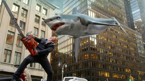 "In this image released by Syfy, Ian Ziering, as Fin Shepard, battles a shark on a New York City street in a scene from ""Sharknado 2: The Second One,"" premiering Wednesday at 9 p.m. EDT. (AP Photo/Syfy)"