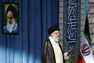 In this picture released by an official website of the office of the Iranian supreme leader, Supreme Leader Ayatollah Ali Khamenei delivers his sermon of the Eid al-Fitr prayer in front of a portrait of the late revolutionary founder Ayatollah Khomeini, in Tehran, Iran, Tuesday, July 29, 2014. (AP Photo/Office of the Iranian Supreme Leader)