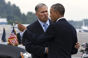 Washington Gov. Jay Inslee, left, greets President Barack Obama as he arrives in Seattle Tuesday, July 22, 2014, at the start of a three-day West Coast trip that is planned to include at least five fundraising events in Seattle, San Francisco and Los Angeles. (AP Photo)