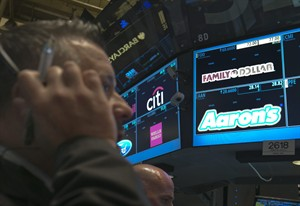 A trader works at the post that handles Family Dollar, on the floor of the New York Stock Exchange Monday, July 28, 2014. THE CANADIAN PRESS/AP, Richard Drew