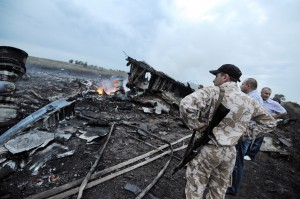 People stand next to the wreckage of a Malaysian airliner after it crashed, near Shaktarsk, Ukraine, on July 17, 2014. AFP/Getty Images/Dominique Faget