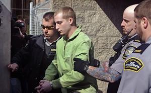 Blake Leggette leaves Halifax Provincial Court on April 22, 2014. THE CANADIAN PRESS/Darren Pittman