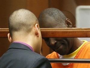 """Actor Michael Jace, right, talks with his attorney Jason Sias in Los Angeles Superior Court during a hearing of the charge that he murdered his wife, Friday, Aug. 1, 2014. Jace waived his right to a preliminary hearing, which means the case will proceed to trial without an initial presentation of evidence to a judge. Jace played a police officer on """"The Shield"""" TV series, appeared in the show """"Southland"""" and had small roles in such movies as """"Boogie Nights"""" and """"Forrest Gump."""" (AP Photo/Frederick Brown, Pool)"""