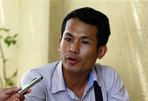 """In this July 28, 2014, photo, Chhin Hun, 23, a student of design and architecture, learned about the Khmer Rouge from his parents and at school. """"My idea is that the tribunal should proceed with its work with fairness, and not delay its proceedings quite often, as it does. The more the trial is delayed, the more worry it causes Cambodians that the two defendants could die before it is completed,"""" Chhin Hun said. A U.N.-assisted genocide tribunal will deliver a verdict this coming Thursday in the trial of the two top leaders of the communist Khmer Rouge, whose extremist policies in the late 1970s are blamed for the deaths of an estimated 1.7 million Cambodians though starvation, medical neglect, overwork and execution. (AP Photo/Heng Sinith)"""