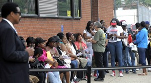 People wait on line at the City of Detroit Water & Sewerage Department at the Eastside Service Center, Saturday, Aug. 2, 2014 in Detroit. The city stopped cutting off water July 21, but that moratorium is supposed to end in a few days. Customer service manager Constance Williams says the city is willing to accept 10 percent down if customers agree to a payment plan. (AP Photo/Detroit News, Todd McInturf) DETROIT FREE PRESS OUT; HUFFINGTON POST OUT