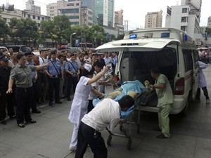 Medical staff move a severely burnt victim of an explosion at an eastern Chinese automotive parts factory from a hospital in the city of Kunshan, Jiangsu Province to a Shanghai hospital, Saturday, Aug. 2, 2014 due to lack of hospital equipment to treat severe burns. Dozens of people were killed Saturday by the explosion at the factory that supplies General Motors, state media reported. (AP Photo) CHINA OUT