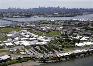 "FILE - This June 20, 2014 aerial file photo shows Riker's Island jail in New York. The city's juvenile jails are extremely violent and unsafe, the result of a deeply ingrained culture of violence in which guards routinely violate constitutional rights of teenage inmates and subject them to ""rampant use of unnecessary and excessive force,"" federal prosecutors said in a scathing report released Monday, Aug. 4, 2014. The island contains adult and juvenile facilities. (AP Photo/Seth Wenig, File)"