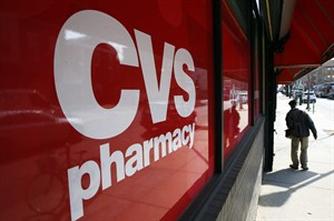 This March 25, 2014 photo shows a CVS store in Philadelphia. CVS Caremark reports quarterly financial results on Tuesday, Aug. 5, 2014. (AP Photo/Matt Rourke)