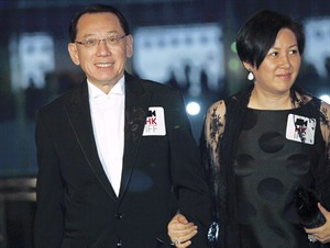 "FILE - In this March 22, 2009 file photo, Albert Yeung, left, chairman of the Hong Kong media conglomerate Emperor Entertainment Group and his wife attend the premiere of his film "" Shinjuku Incident "" as part of the kickoff for The 33rd Hong Kong International Film Festival in Hong Kong. A court has ruled that the Hong Kong tycoon can sue Google over its autocomplete results suggesting he has links to organized crime. In a judgment released Wednesday, Aug. 6, 2014, the court dismissed the Internet search giant's objections to tycoon Albert Yeung's defamation lawsuit.(AP Photo/Vincent Yu, File)"