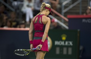Eugenie Bouchard, from Montreal, reacts during her match against Shelby Rogers, of the United States, during first round play at the Rogers Cup tennis tournament Tuesday August 5, 2014 in Montreal. THE CANADIAN PRESS/Paul Chiasson