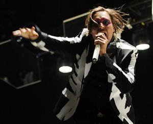 FILE - In this April 13, 2014 file photo, Win Butler of Arcade Fire performs during their headlining set on the third day of the 2014 Coachella Music and Arts Festival in Indio, Calif. Internet radio leader Pandora has come to its first-ever direct licensing deal with artists, a wide-ranging agreement with independent label group Merlin, who represents Arcade Fire, that both said would mean higher payments to artists and more play for them on Pandora stations. (Photo by Chris Pizzello/Invision/AP, File)