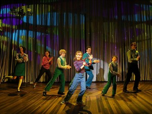 """This image released by The Public Theater shows the cast during a performance of """"Fun Home."""" Producers of the offbeat but refreshing show said Thursday, Aug. 7, 2014, they will mount the show this spring at the Circle in the Square Theatre in New York. Performances will begin April 4 and the direction of Sam Gold. (AP Photo/The Public Theater, Joan Marcus)"""