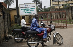 Motorcycle taxi men wait outside the gate of Mainland hospital were suspected Ebola virus victims are quarantined in Lagos, Nigeria, Thursday, Aug. 7, 2014. Authorities in West African are battling to contain the spread of Ebola but will have to wait for months until a potentially life-saving experimental drug known as ZMapp, which was used on two Americans infected with the dreaded disease, could be produced for use in Africa.(AP Photo/Sunday Alamba)