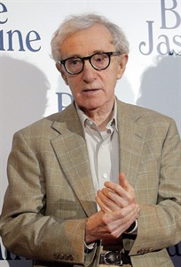 """FILE - In this Aug. 27, 2013, file photo, director and actor Woody Allen appears at the French premiere of """"Blue Jasmine,"""" in Paris. Allen has added his handprints to the Hollywood Walk of Fame, located in Pawtucket, R.I., but not the one in California. Allen was in town on Thursday, Aug. 7, 2014, filming a new movie, and he agreed to add his handprints to the small """"walk of fame"""" in the old mill town. Allen put his prints into wet cement Thursday afternoon, and it will be installed at a later date. (AP Photo/Christophe Ena, File)"""