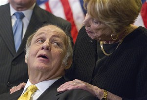 FILE - This March 30, 2011, file photo shows former White House press secretary James Brady, left, who was left paralyzed in the Reagan assassination attempt, looking at his wife Sarah Brady, during a news conference on Capitol Hill in Washington marking the 30th anniversary of the shooting. This week's death of former White House press secretary James Brady, who survived a gunshot wound to the head in a 1981 assassination attempt on President Ronald Reagan, has been ruled a homicide, District of Columbia police said Friday, Aug. 8, 2014. (AP Photo/Evan Vucci, File)