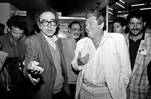 """FILE - In this May 17, 1987 file photo, Swiss movie director Jean-Luc Godard, left, and Israeli producer Menahem Golan, right, gesture as they speak to the press in Cannes, France, after the screening of Godard's out of competition """"King Lear,"""" produced by Cannon group, as part of the 40th Cannes Film Festival. Golan, a veteran Israeli filmmaker who produced some of the biggest action movies of the 1980s, has died in Tel Aviv. He was 85. (AP Photo/Pierre Gleizes, File)"""
