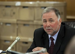 Pierre Paradis listens to testimonies Monday, September 12, 2011 at the legislature in Quebec City. Quebec's new agriculture minister is promising to clean up the province's bad reputation as one of the best places to be an animal abuser. THE CANADIAN PRESS/Jacques Boissinot