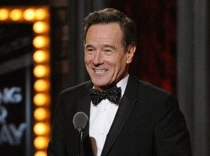 """FILE - This June 8, 2014 file photo shows Bryan Cranston accepting the award for best performance by an actor in a leading role in a play for """"All The Way"""" on stage at the 68th annual Tony Awards at Radio City Music Hall in New York. Cranston, Julia Roberts, and Gwen Stefani are among a group of presenters announced for the Emmy Awards on Aug. 25. (Photo by Evan Agostini/Invision/AP, File)"""