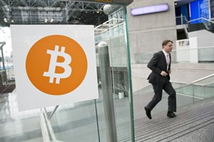 FILE - In this April 7, 2014 file photo, a man arrives for the Inside Bitcoins conference and trade show in New York. A hacker with access to a Canadian Internet provider hijacked net traffic from large foreign networks to steal more than US$83,000 in virtual currency over a four-month period, a cyber security company said Monday. THE CANADIAN PRESS/AP, Mark Lennihan,