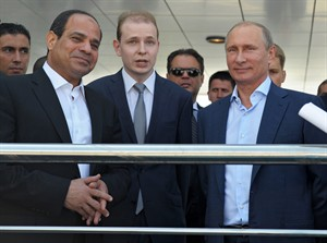 Russian President Vladimir Putin, right, and Egyptian President Abdel-Fattah el-Sissi, second left, listen to a translator during a meeting in the Russian Black Sea resort of Sochi, Russia, Tuesday, Aug. 12, 2014. El-Sissi is on his first visit to Russia. (AP Photo/RIA Novosti, Alexei Druzhinin, Presidential Press Service)