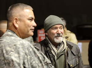 This Dec. 15, 2010 photo released by the U.S. Department of Defense shows actor-comedian Robin Williams, right, with U.S. Army Maj. Gen John F. Campbell, Combined Joint Task Force 101 and Regional Command East commander, before the annual USO Holiday Tour at Bagram Air Field, in Afghanistan. Members of the armed forces have long held special affection for Williams, 63, who died Monday, Aug. 11, 2014 after hanging himself in his San Francisco Bay Area home. Williams never served in the military, but he was a tireless participant in USO shows. (AP Photo/U.S. Department of Defense, Staff Sgt. Michael Sparks)