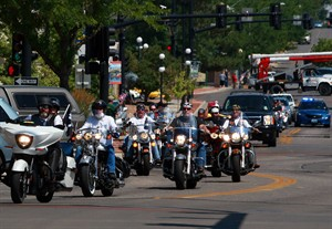 Law enforcement and members of the Patriot Guard Riders escort the casket of Army Pfc. Lawrence Samuel Gordon through downtown Casper, Wyo. on Sunday afternoon, Aug. 10, 2014. Gordon, who worked on a ranch outside Casper before enlisting to fight in World War II, was killed in action in France and buried as an unknown soldier. His remains were recently identified by DNA and are being returned to his hometown of Eastend, Saskatchewan, Canada. (AP Photo/Casper Star-Tribune, Alan Rogers) MANDATORY CREDIT