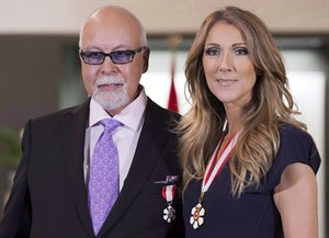 Canadian music star Celine Dion and husband Rene Angelil pose for photos after being decorated with the Order of Canada in Quebec City on Friday July 26, 2013. Dion is suspending all of her show business activities to focus on the ailing health of husband. Angelil had surgery last December to have a cancerous tumour removed. THE CANADIAN PRESS/Jacques Boissinot