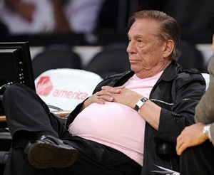 FILE - In this Oct. 16, 2010, file photo, Los Angeles Clippers team owner Donald Sterling watches his team play the Utah Jazz during the second half of their preseason NBA basketball game in Los Angeles. Steve Ballmer is officially the new owner of the Clippers. The team says the sale closed Tuesday, Aug. 12, 2014, after a California court confirmed the authority of Shelly Sterling, on behalf of the Sterling Family Trust, to sell the franchise.(AP Photo/Mark J. Terrill, File)