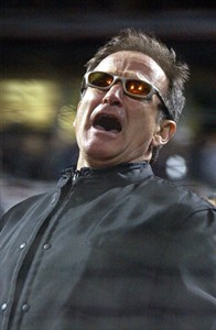 "FILE - In this Oct. 22, 2002 file photo, actor Robin Williams sings ""Take Me Out to the Ballgame"" in the seventh inning during game 3 of the World Series in San Francisco. Williams was everywhere in San Francisco, it seemed, as he made a place for himself in the everyday fabric of a city where he once said he passed for normal. (AP Photo/Julie Jacobson, File)"