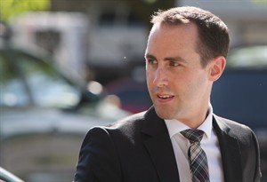 Defendant Michael Sona walks to the courthouse in Guelph, Ont., June 4, 2014. An Ontario judge is set to determine the fate of a Conservative party staffer charged with preventing voters from casting their ballots during the 2011 federal election. Justice Gary Hearn's decision on whether 25-year-old Michael Sona plotted to obstruct voters is expected to come down Aug. 14 in Guelph. THE CANADIAN PRESS/Dave Chidley