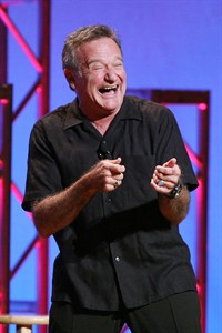 "This Nov. 23, 2009 photo released by Starpix shows actor-comedian Robin Williams performing his stand-up show, ""Weapons of Self Destruction,"" at Town Hall in New York. Williams' wife Susan Schneider released a statement Thursday, Aug. 14, 2014 announcing that Williams had early stages of Parkinson's disease. He died Monday of an apparent suicide at the age of 63. (AP Photo/Starpix, Dave Allocca)"