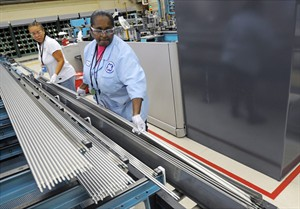In this July 30, 2014 photo, quality control inspector Tina Person, left, and scanner pperator Dewanna Murphy inspect tubes that are used in the production of the fuel bundle assembly at the GE Hitachi plant in Castle Hayne, N.C. (AP Photo/The Star-News, Mike Spencer)