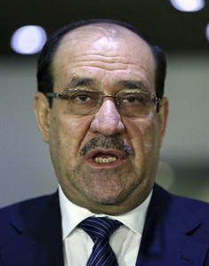 FILE - In this Saturday, July 26, 2014 file photo, Iraqi Prime Minister Nouri al-Maliki speaks during a news conference with the Sunni Speaker of Parliament Salim al-Jubouri, in Baghdad, Iraq. Iraq's Nouri al-Maliki has given up his post as prime minister to Haider al-Abadi, state television reported Thursday, Aug. 14, 2014 — a move that could end a political deadlock that plunged Baghdad into uncertainty as the country fights a Sunni militant insurgency. (AP Photo/Hadi Mizban, File)