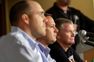 Stewart-Haas Racing executive vice president Brett Frood, left, crew chief Greg Zipadelli, center, and driver Jeff Burton are shown during a news conference at Michigan International Speedway in Brooklyn, Mich., Friday, Aug. 15, 2014. Tony Stewart will not race Sunday at Michigan International Speedway, skipping a second straight NASCAR Sprint Cup race since striking and killing a driver in a dirt-track race at a small New York track. Jeff Burton will drive Stewart's No. 14 Chevrolet in Michigan. (AP Photo/The Jackson Citizen Patriot, Brian Smith) ALL LOCAL TELEVISION OUT; ALL LOCAL INTERNET OUT