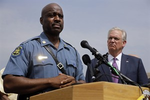 FILE - In this Aug. 15, 2014 file photo, Capt. Ron Johnson of the Missouri Highway Patrol, left, and Missouri Gov. Jay Nixon take part in a news conference in Ferguson, Mo. Nixon assigned protest oversight to Johnson after violent protests in Ferguson erupted in the wake of the fatal shooting of Michael Brown by a police officer on Aug. 9. (AP Photo/Jeff Roberson, File)
