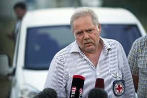 Pascal Cuttat, Head of the Regional delegation of the ICRC for the Russian Federation Belarus and Moldova, speaks to press at the Russia-Ukraine border control point in Russian town Donetsk, Rostov-on-Don region, Russia, Saturday, Aug. 16, 2014. (AP Photo/Pavel Golovkin)