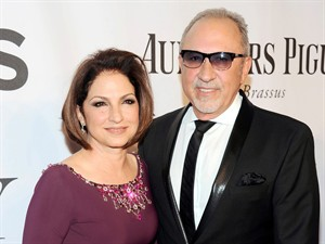 "FILE - In this June 8, 2014, file photo, Gloria Estefan, left, and Emilio Estefan pose for photos at the 68th annual Tony Awards at Radio City Music Hall in New York. Producers of ""On Your Feet!"" a musical about the Estefans, said Monday, Aug. 18, 2014, they'll offer performers around the world a chance to audition for all the roles in the Broadway cast by submitting audition videos online. There also will be two open casting calls _ at Pearl Studios in New York City on Sep. 9 and at the Adrienne Arsht Center for the Performing Arts in Miami on Sept. 21. (Photo by Charles Sykes/Invision/AP, File)"