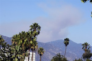 Smoke from a wildfire rises above the San Gabriel Mountains above Azusa, Calif., Sunday, Aug. 17, 2014. A wildfire in the Angeles National Forest in Southern California is forcing people to evacuate from a campground and recreational areas. U.S. Forest Service spokesman Nathan Judy says the fire above the foothill community of Azusa was reported about 2:30 p.m. Sunday. (AP Photo/John Antczak)