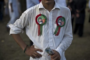 A supporter of Pakistani cricketer-turned-politician Imran Khan, wearing pins bearing the image of Khan, takes part in a protest in Islamabad, Pakistan, Tuesday, Aug. 19, 2014. Khan on Monday announced to lead thousands of anti-government protesters into the high security 'Red Zone' as his 48 hours deadline for government to step down ending Tuesday. (AP Photo/Muhammed Muheisen)