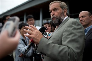 NDP Leader Thomas Mulcair responds to questions as MP Nathan Cullen, right, listens during a media availability in Vancouver, B.C., on Tuesday August 19, 2014. THE CANADIAN PRESS/Darryl Dyck