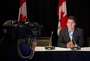 Liberal Leader Justin Trudeau speaks during a media availability at the federal Liberal Party's summer caucus meeting in Edmonton on Tuesday, Aug. 19, 2014. THE CANADIAN PRESS/Jason Franson