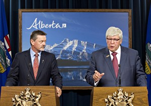 Alberta Premier Dave Hancock, right, and Doug Horner, President of Treasury Board and Minister of Finance, provide an update on the government's response to recommendations in the Auditor General's Special Duty Report on the Expenses of the Office of Premier Redford and Alberta's Air Transportation Services Program, in Edmonton on Tuesday, Aug. 19, 2014. THE CANADIAN PRESS/Jason Franson