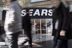 Commuters walk past a Sears store in Toronto on Thursday April 25, 2013. Sears Canada Inc. reported a net loss of $21.3 million, or 21 cents per share, in the second quarter, compared to a profit of $152.8 million, or $1.50, in the same period last year. THE CANADIAN PRESS/Chris Young