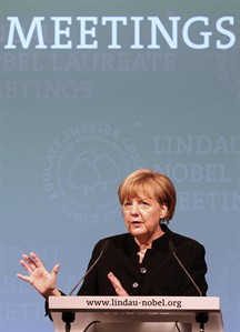 German chancellor Angela Merkel delivers a speech at a meeting of Economic Scientists with more than a dozen of Nobel Laureates in Lindau, Germany, Wednesday, Aug. 20, 2014. Chancellor Angela Merkel's emergence as a leader in efforts to resolve Ukraine's crisis — showcased by a visit to Kiev this weekend — underlines Germany's increasing ambition to transform itself from economic power to diplomatic heavyweight. Merkel and her foreign minister, Frank-Walter Steinmeier, have put Berlin at the forefront of so-far frustrating diplomatic efforts, as many European nations focus on domestic troubles and the U.S. is engaged in crises elsewhere. (AP Photo/dpa, Karl-Josef Hildenbrand)