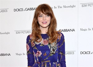 """FILE - This July 16, 2014 file photo shows actress Emma Stone arrives at the premiere of """"Magic In The Moonlight"""" in New York. Roundabout Theatre Company said Wednesday that Stone will make her Broadway debut Nov. 11 as Sally Bowles, in """"Cabaret,"""" taking over from Michelle Williams at the Studio 54 theater. (Photo by Evan Agostini/Invision/AP, FIle)"""