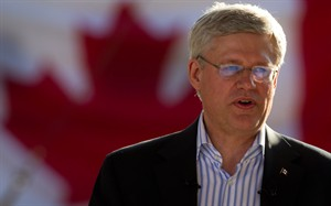 Prime Minister Stephen Harper addresses supporters during a party gathering at Krause Berry Farms in Langley, B.C., on Wednesday August 20, 2014. THE CANADIAN PRESS/Darryl Dyck