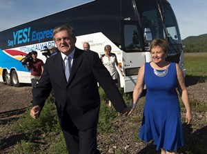 New Brunswick Premier David Alward and his wife Rhonda arrive in the rural community of Penobsquis to launch his re-election bid on Thursday, August 21, 2014. The provincial election is September 22. THE CANADIAN PRESS/Andrew Vaughan
